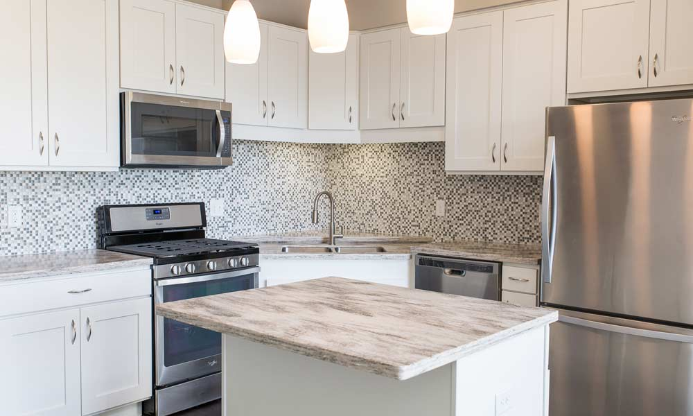 Model kitchen with glass and marble mosaic tiles