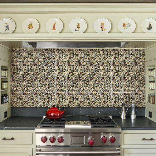 Wolf stove surrounded by custom cabinets and vintage style tile backsplash