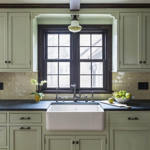Beautiful farmhouse sink with soapstone countertops and window to outside